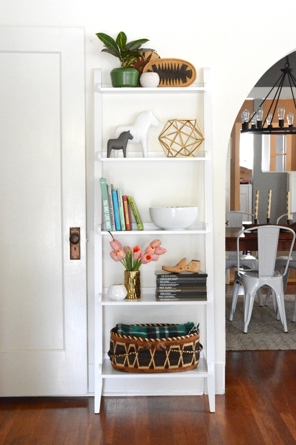 How To Decorate A Brown Living Room: Leaning Bookcase